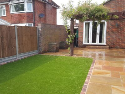 a picture of garden landscaping with sandstone walk way